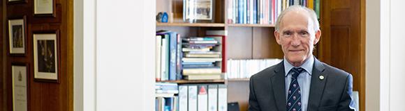Vice-Chancellor Sir David Greenaway sat by his desk