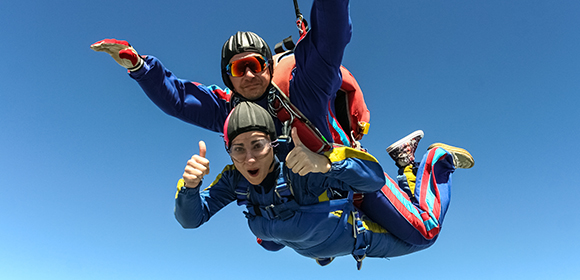 A couple skydiving