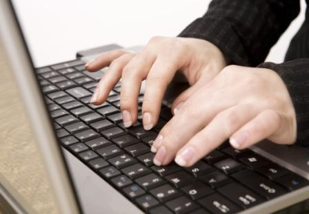 Image:  hands typing on a laptop keyboard