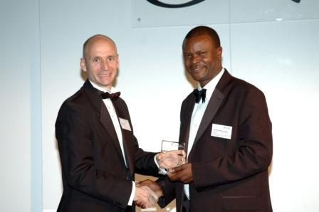 Dr Peter Masibo Lumala receiving his award