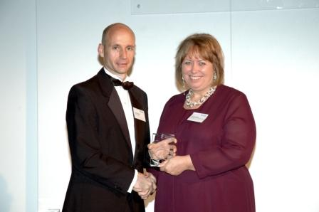 Ann Dudley receiving her award