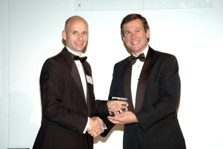 Roger Lewis receiving his award