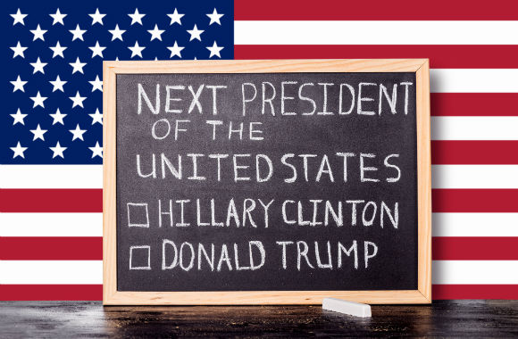 USA flag with a blackboard reading: 'Next president of the United States. (checkbox) Hillary Clinton. (checkbox) Donald Trump'