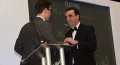 Roberto Hernan receiving a Staff Oscar